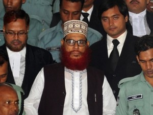 In this photograph taken on August 18, 2011, JI leader Delwar Hossain Sayedee (C) emerges from the Bangladesh International Crimes Tribunal in Dhaka. PHOTO: AFP